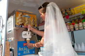 Bride Rachael Whittaker prepares an Ice Cream Cone.