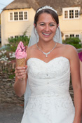 Just married bride enjoying an Ice Cream by Mister Nice Cream in Oxfordshire.